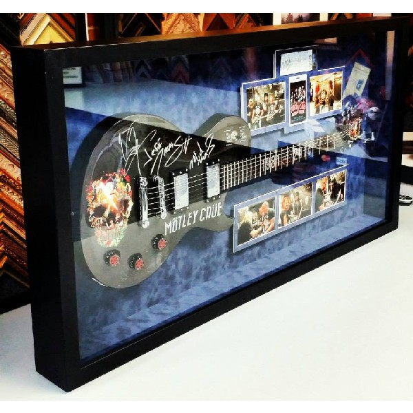 Motley Crue Autographed Guitar and Pictures
